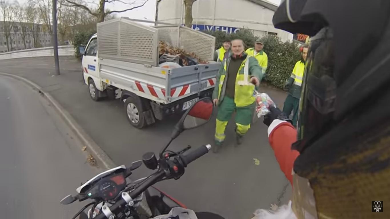 Biker Gives Away Christmas Gifts on the Road
