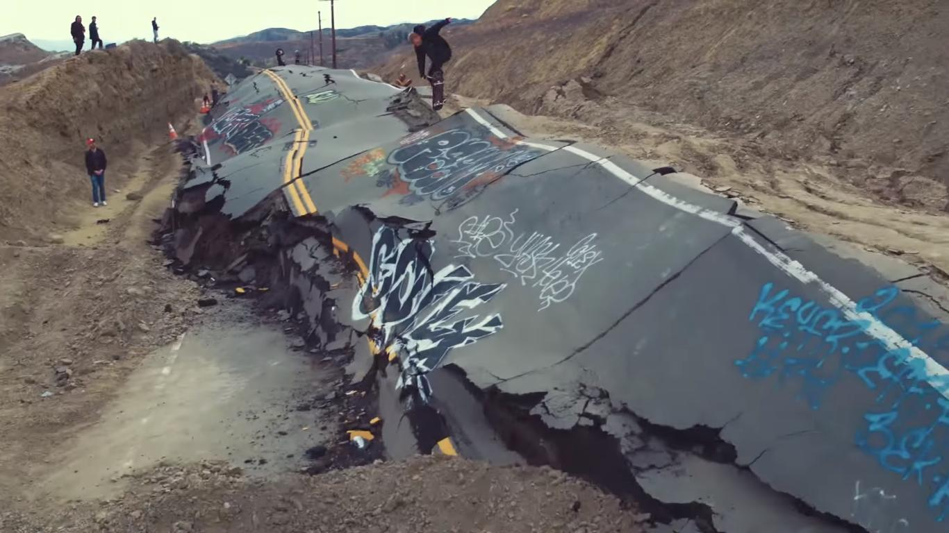 They Ride a Destroyed Road with Their Skateboards