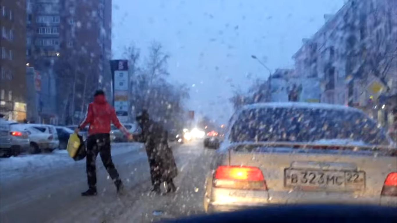 Russian Driver Helps an Old Lady to Cross the Snowy Street