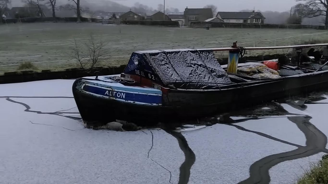 Footage of a Boat Breaking Through a Frozen Canal