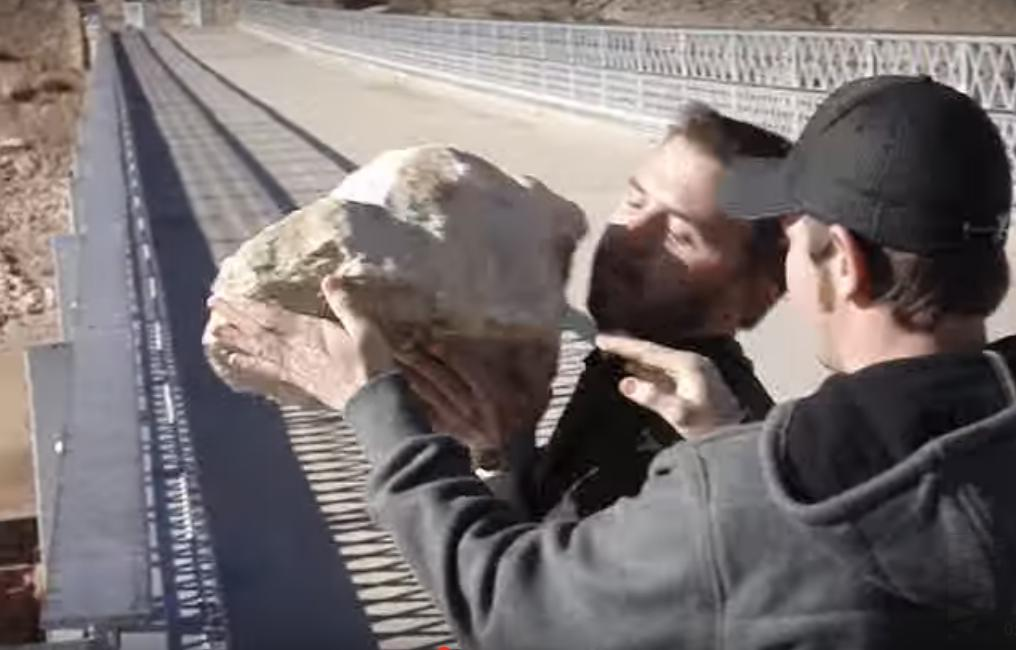 They Drop a Huge Rock off a Bridge into the Water