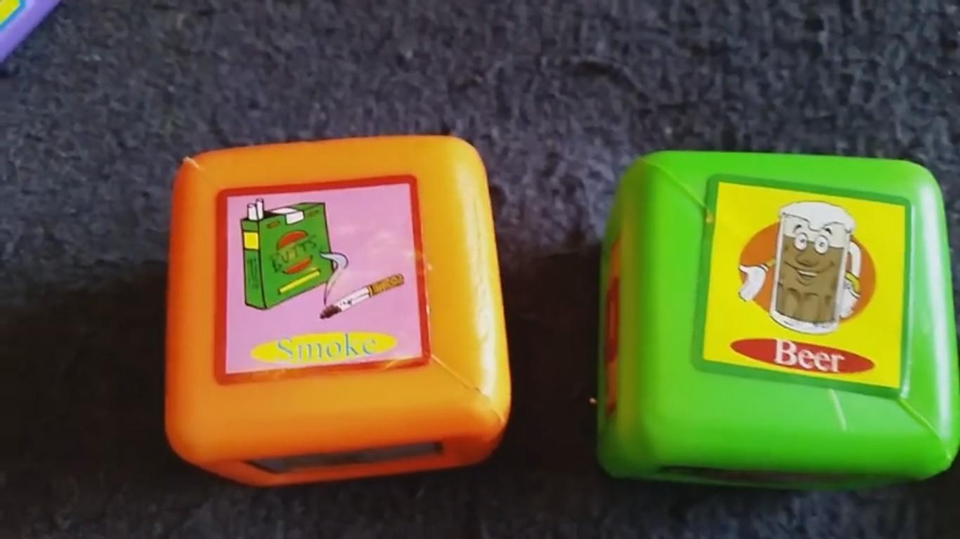 Plastic Learning Blocks for Kids Have Beer and Cigarettes Stickers on Them