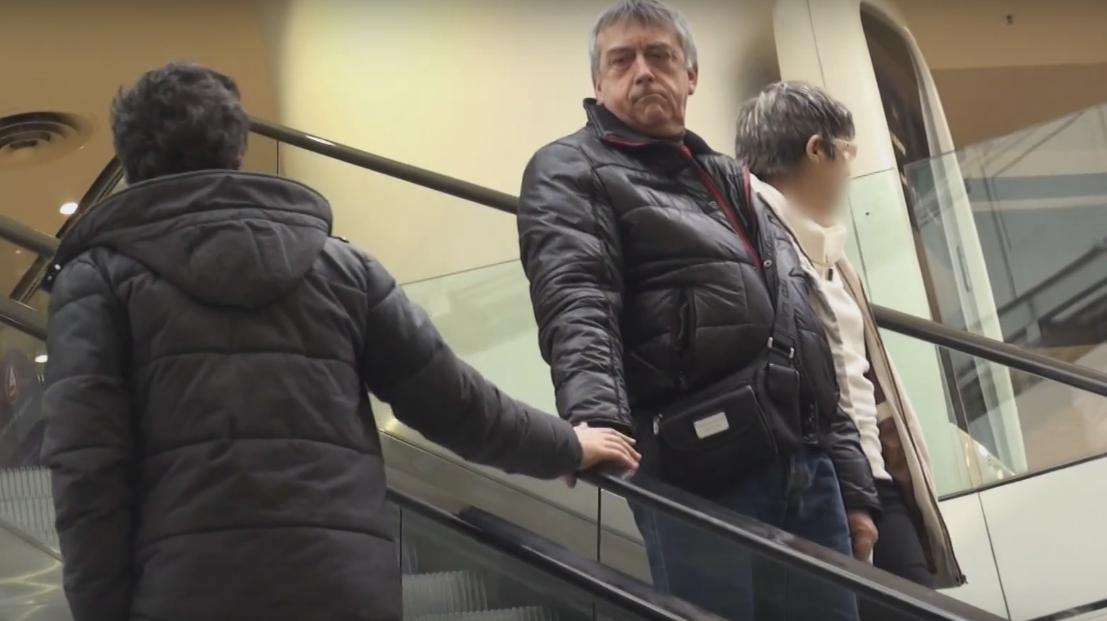 Guy Randomly Touches People Hands on Other Side of the Escalator