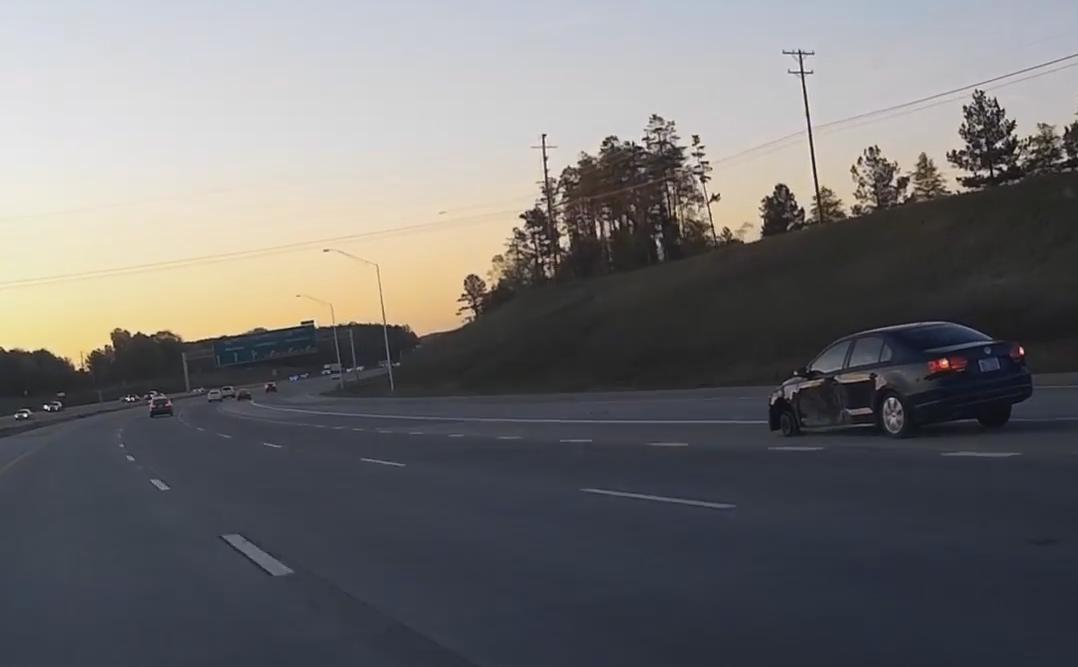 Car Driving With Only Three Wheels on the Highway